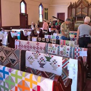 Quilt show in sanctuary