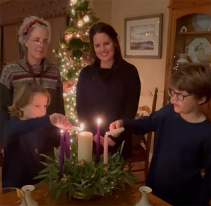 The Richardson family lights Advent candles