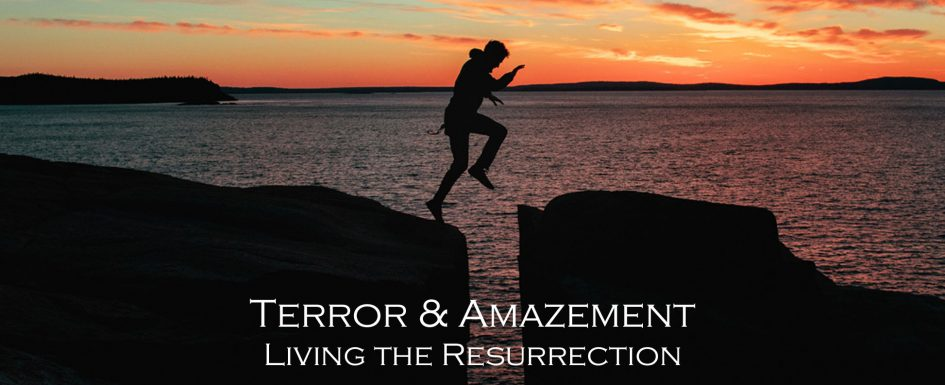 Terror and Amazement. Person leaping from one rock to another with ocean in background.